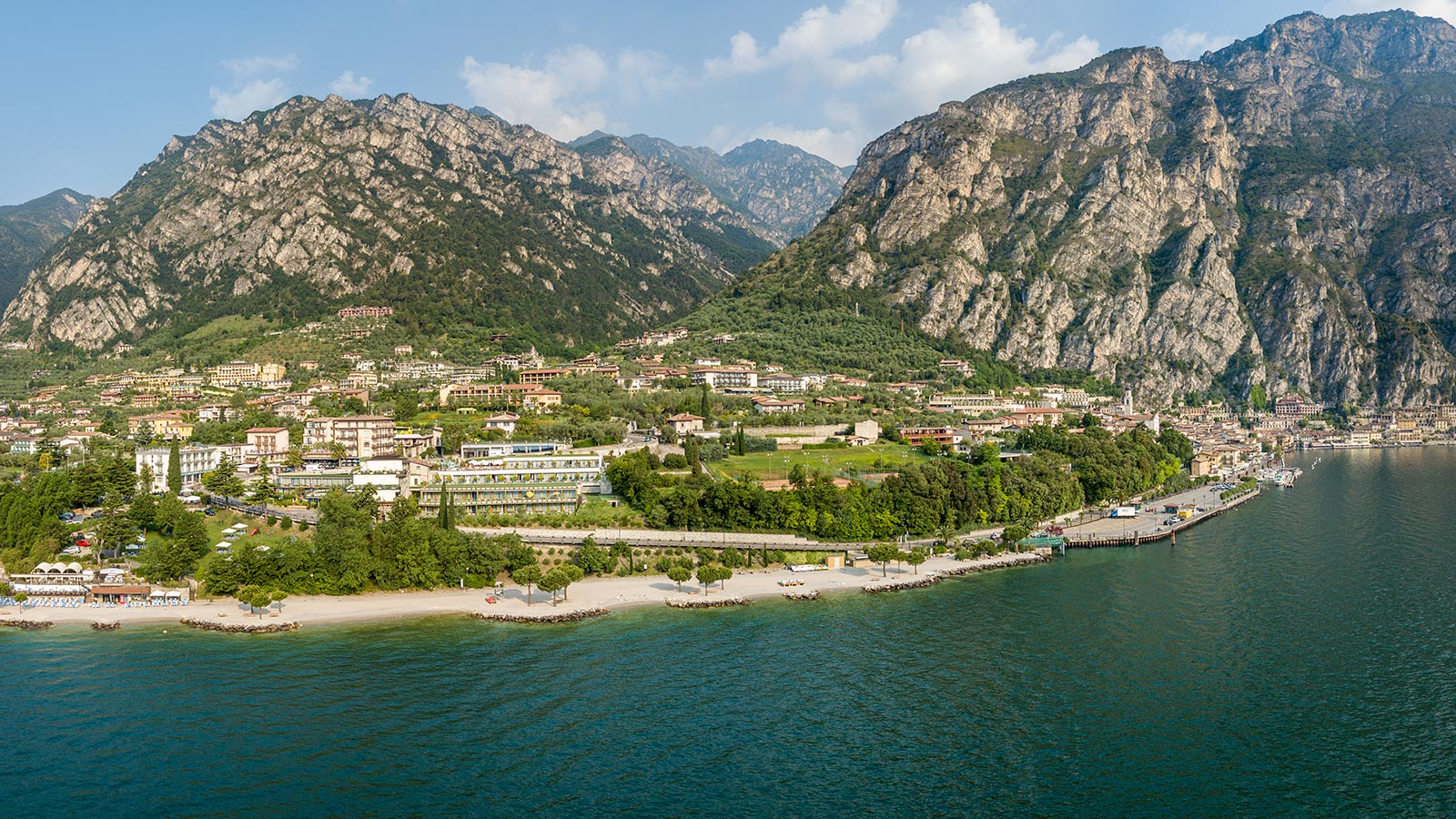 Panoramic view of Limone sul Garda with mountains and the lake's shore