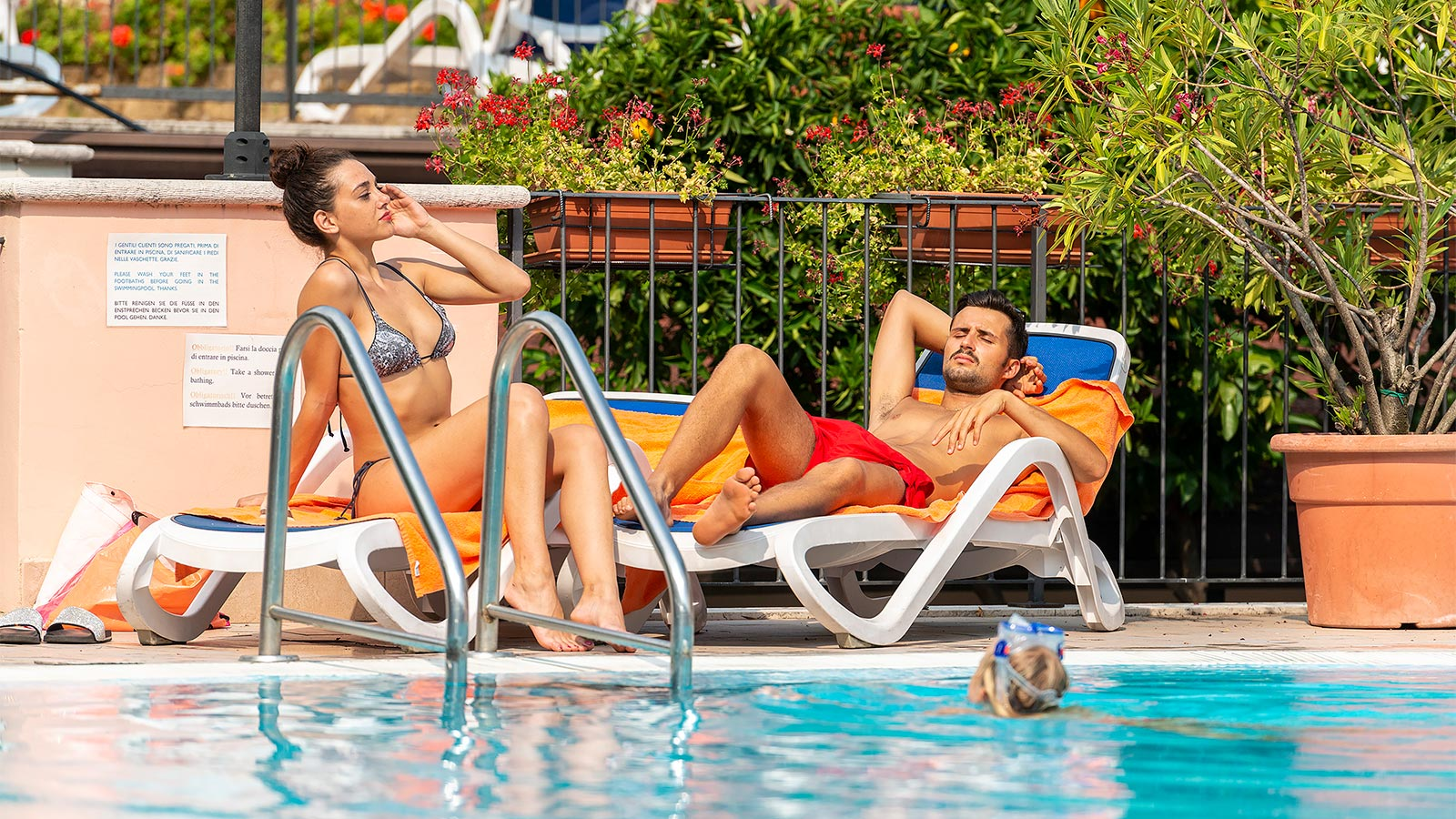 Couple relaxing near the pool
