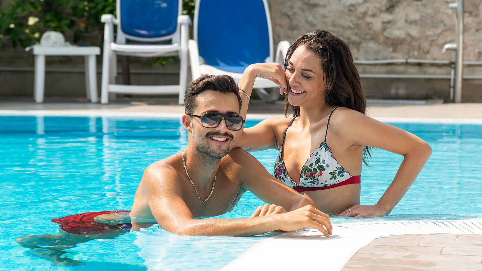 Young couple relaxing in the pool