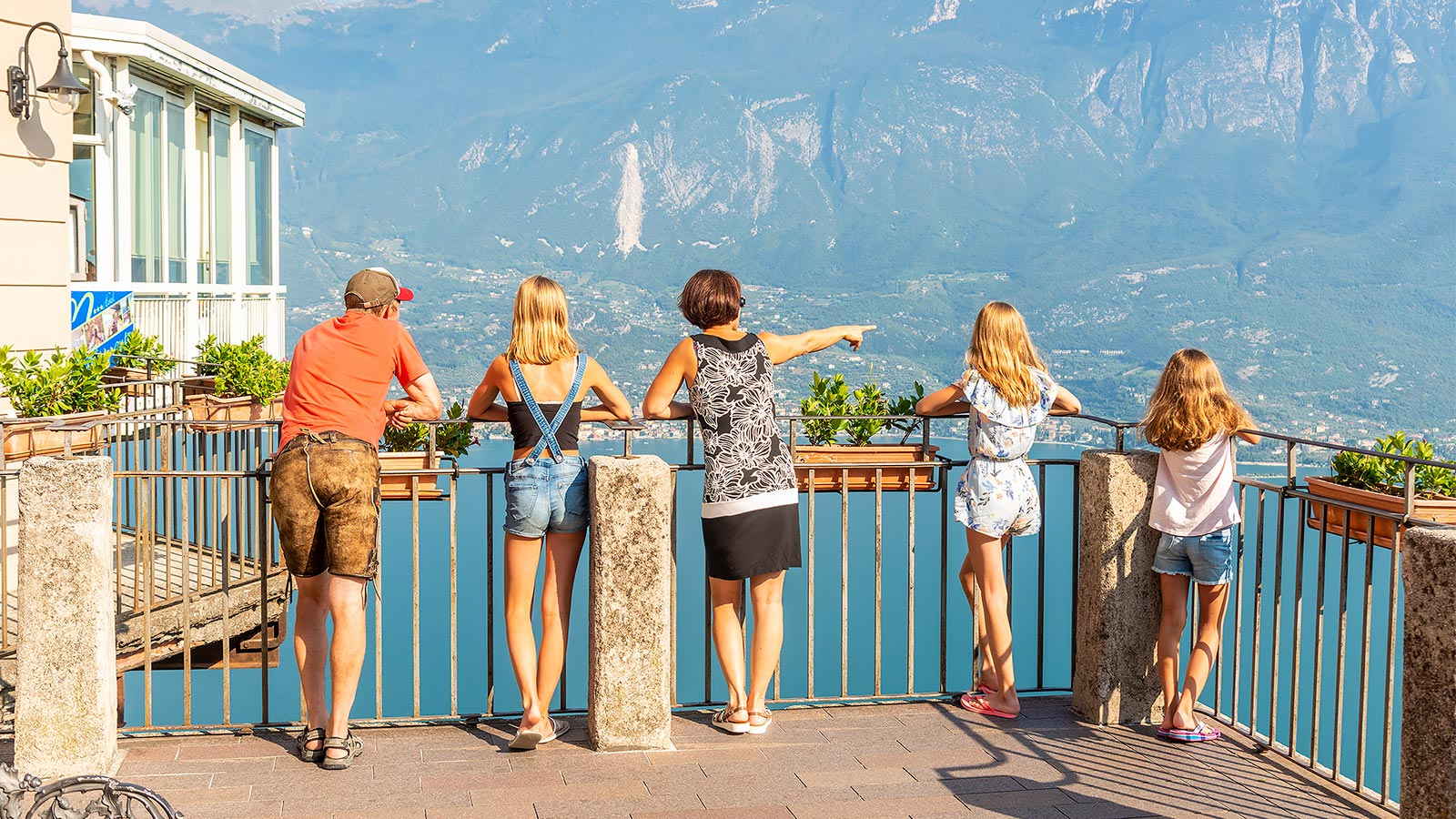 Family adminirng the view of Lake Garda
