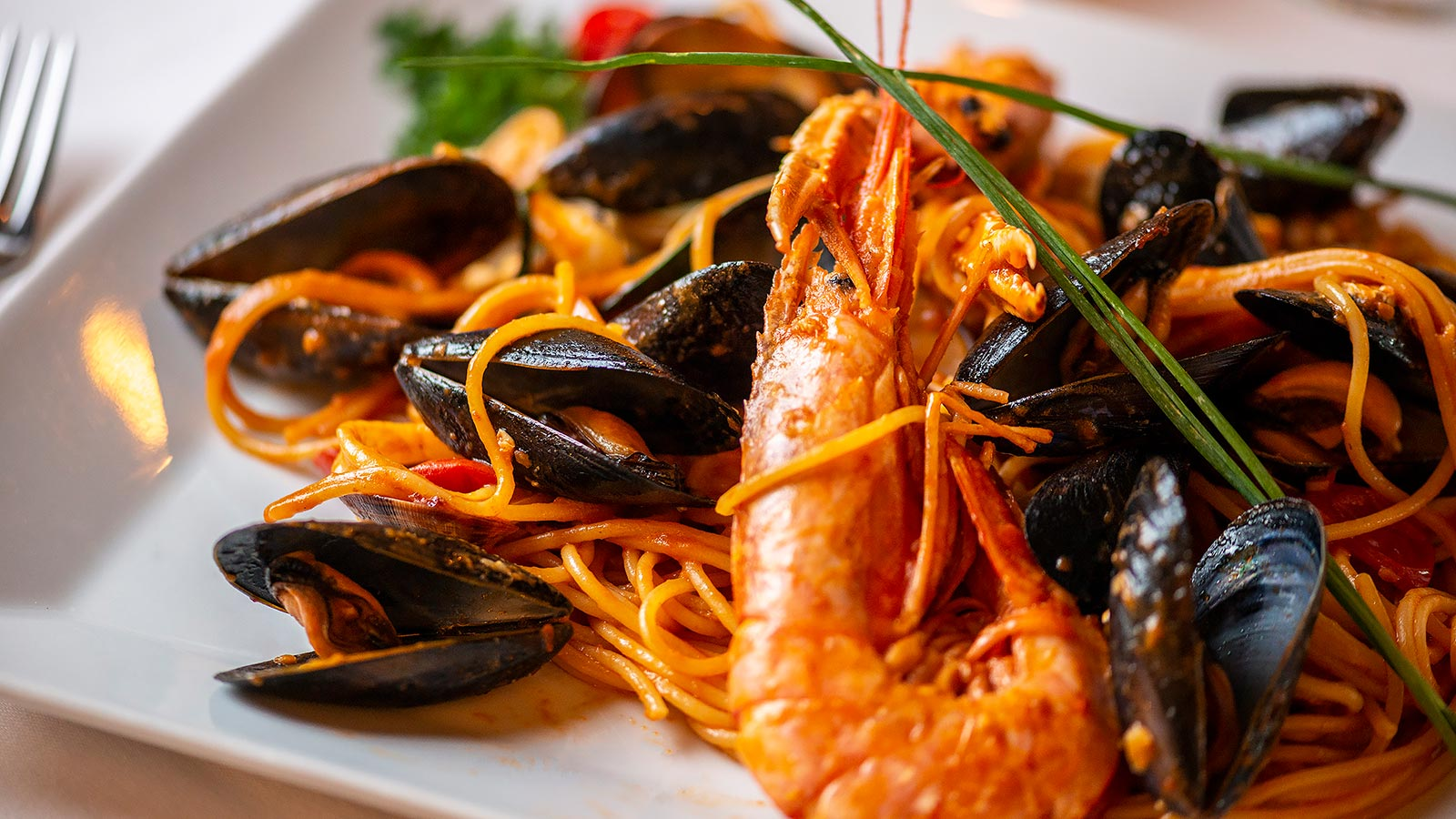 Spaghetti ai frutti di mare at restaurant in limone lake garda