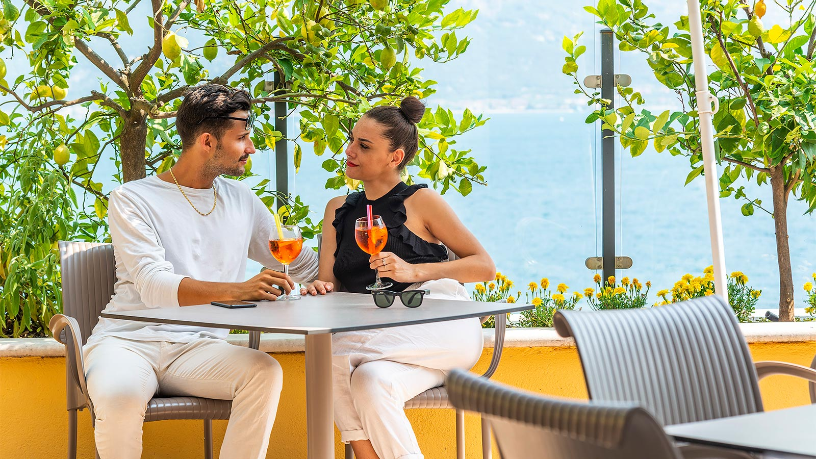 Young couple having an aperitivo on the terrace of Hotel Villa Dirce